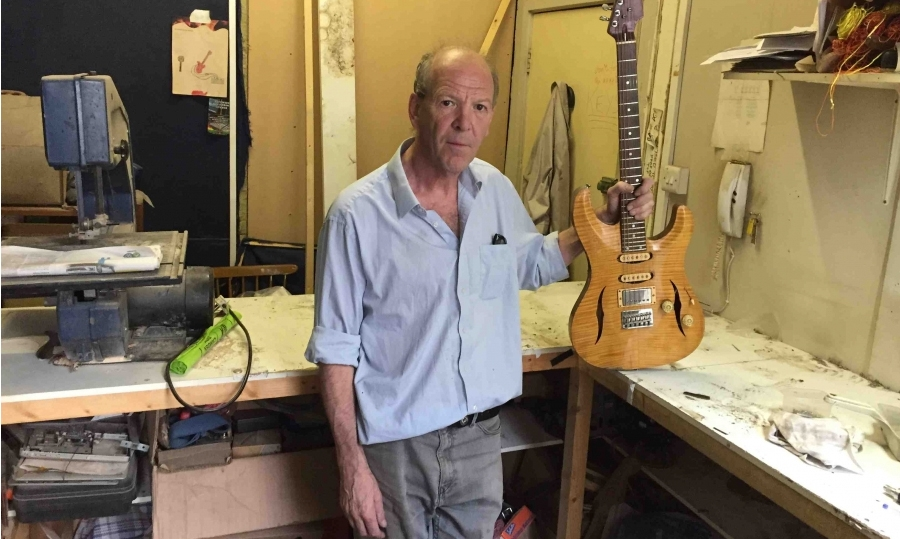 Guitar maker forced out by developer